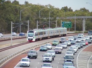 https://en.wikipedia.org/wiki/Joondalup_railway_line#/media/File:Mitchell_Freeway_100_N_Stirling_Civic_with_train.jpg